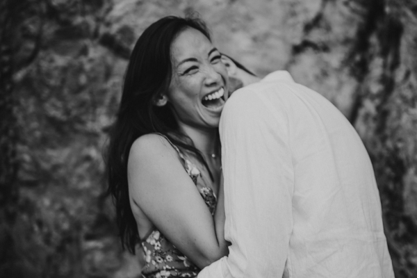 Black and white photo of couple laughing and hugging