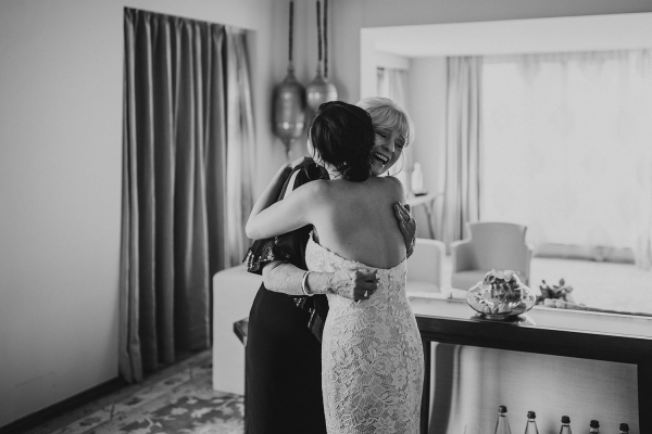 Black and white photo of bride hugging mother in law