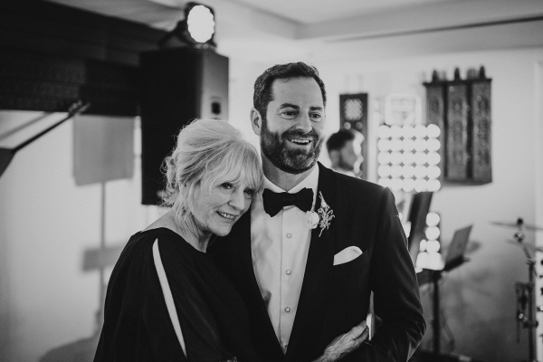 Black and white image of groom and his mother