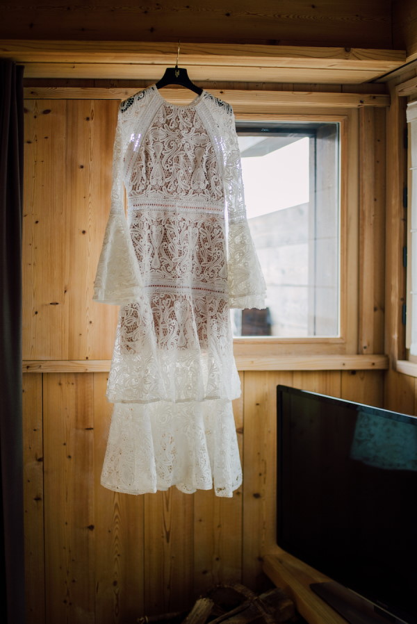 White lace dress hanging from pine interior of French chalet