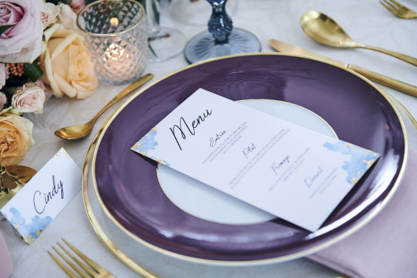 purple wedding plate with menu card and gold cutlery