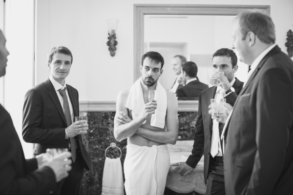 Groom and groomsmen getting ready in black and white