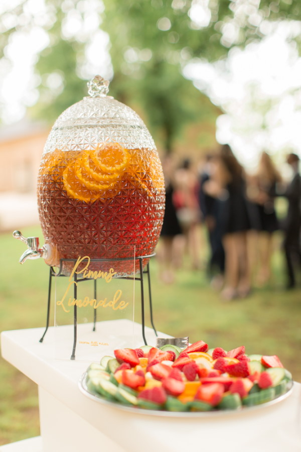 Hostess filled with Pimms lemonade for guests