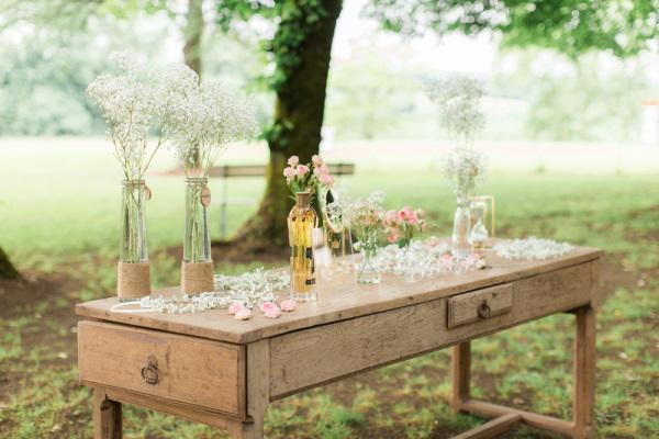 Wedding bar set up on old wooden desk in garden