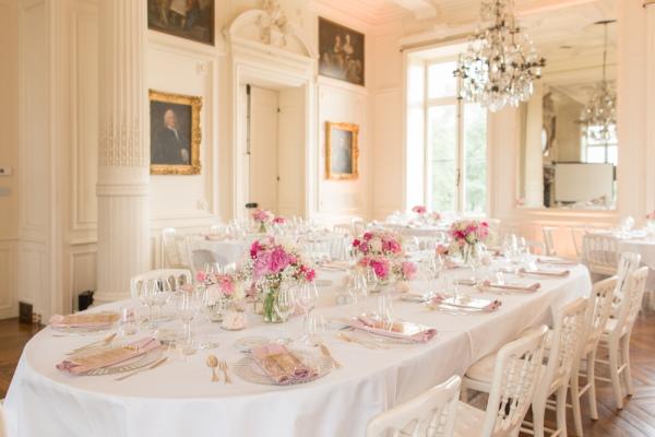 Indoor wedding table at Chateau d'Azy adorned with pink posies