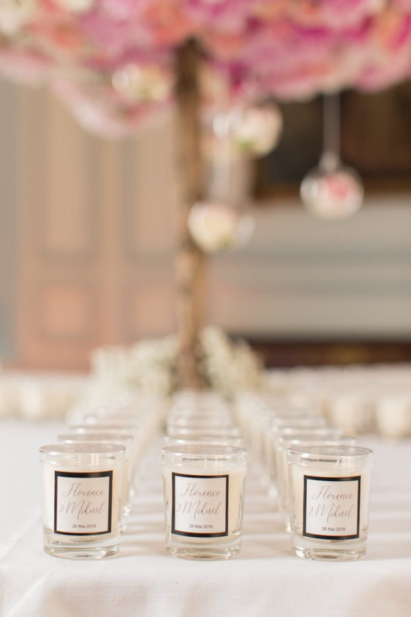Wedding favours of rows of personalised jar candles