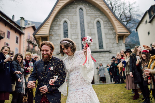Wedding guests shower bride and groom in sustainable bird seed confetti