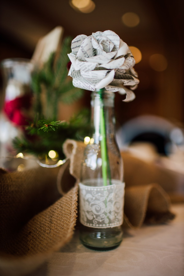 Zero waste wedding decoration made from recycled paper into rose, in old bottle covered in recycled lace