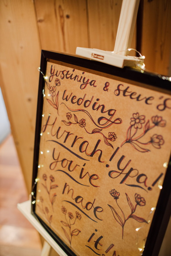 Old recycled photo frame with wooden back makes wedding welcome sign
