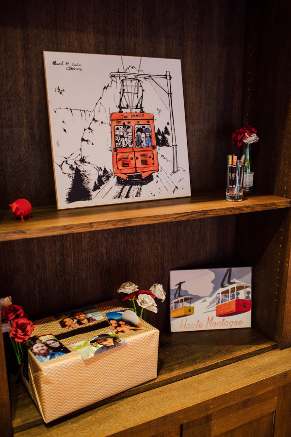 Bookshelf in French Alps Hotel with chairlift art and photos