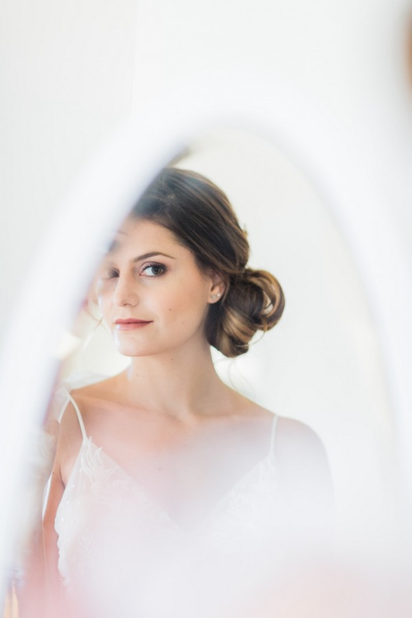 bride with up-do in mirror reflection