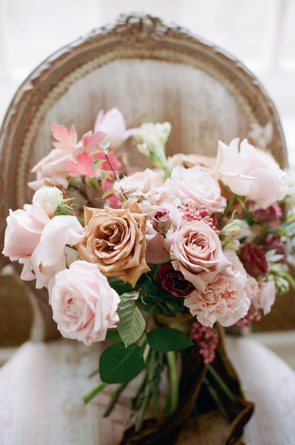 pink, coffee and burgundy roses in bouquet