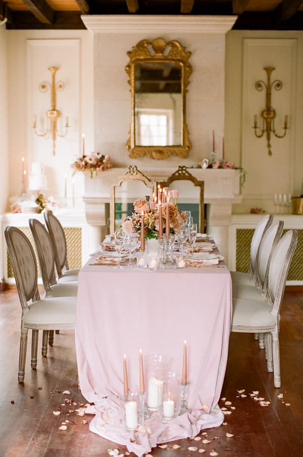 6 seater dining table with pink accents set up for a micro wedding a la francaise