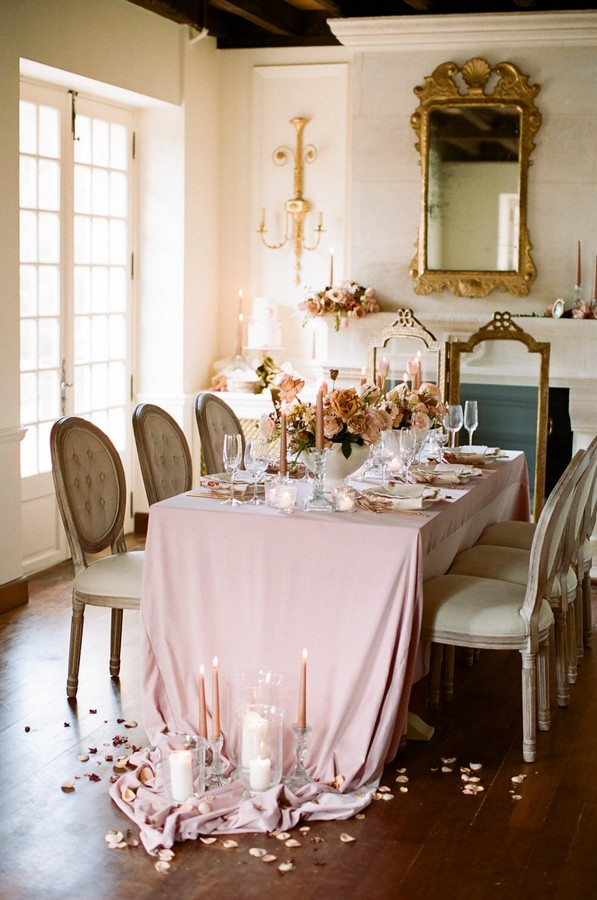 pink embellished dining table with candles and petals
