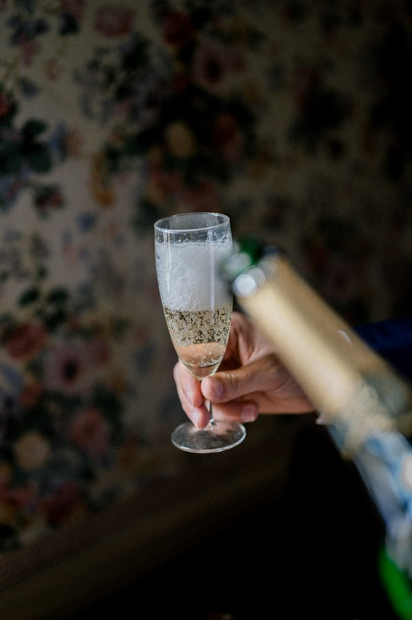 Glass of champagne being poured