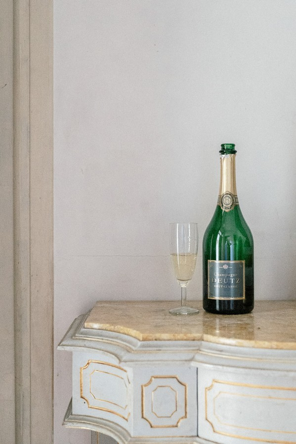 Champagne bottle and glass on side table