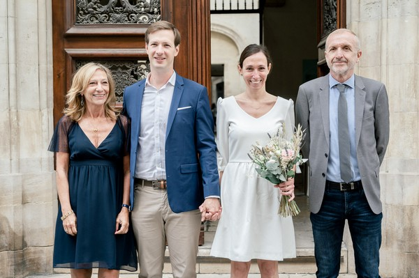 Bride and groom with father and mother