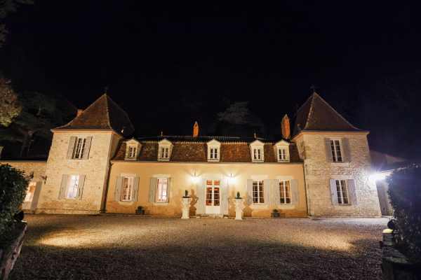 Chateau Lacanaud at night illuminated by uplights