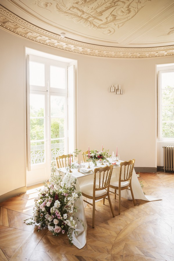 wedding table dressed in white with white floral arrangements