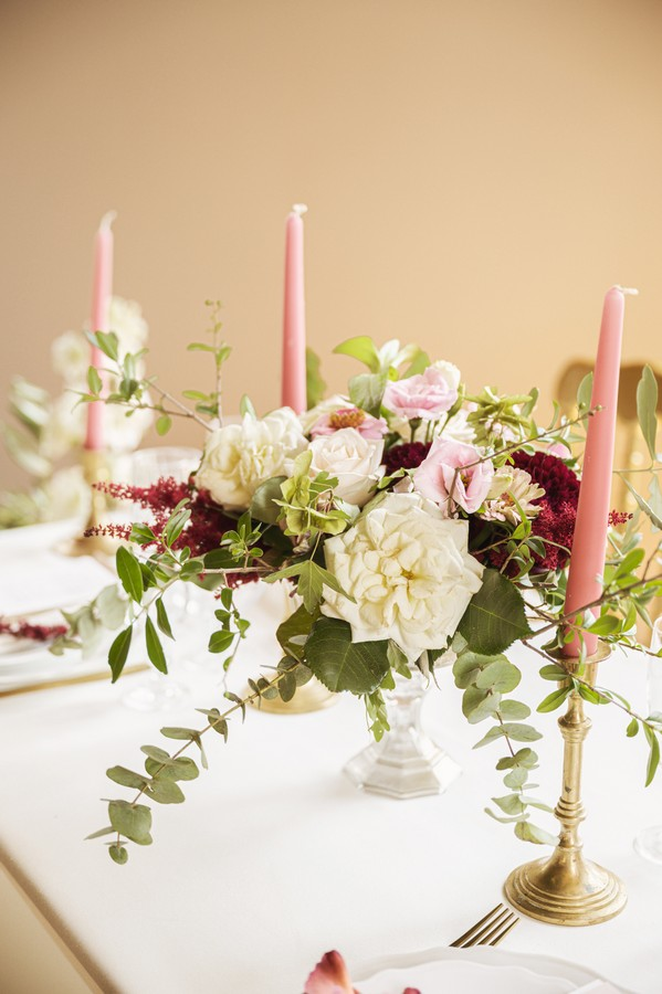 pink candles and white, pink and burgundy table flowers