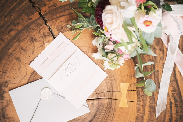 white wedding stationery with white wax seals