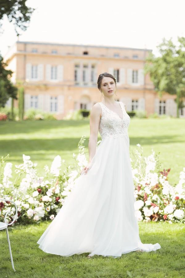 bride on green grass outside Chateau de Roquefoulet