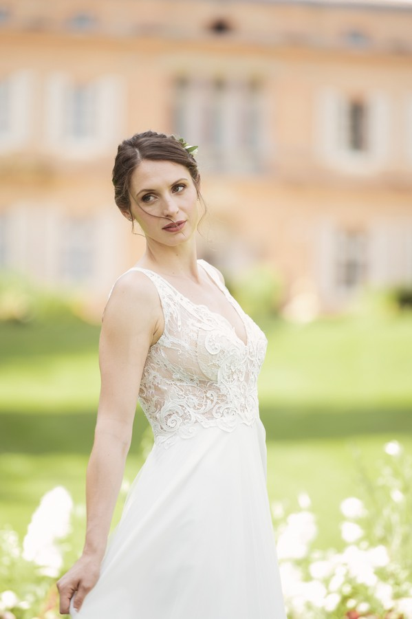 bride in lace white bridal gown with burgundy lipstick and up-do