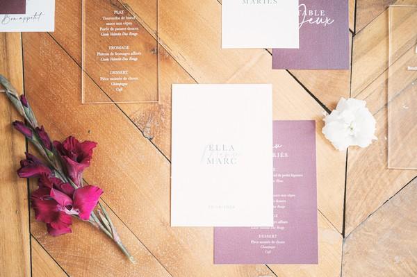 flatlay of burgundy and white stationery