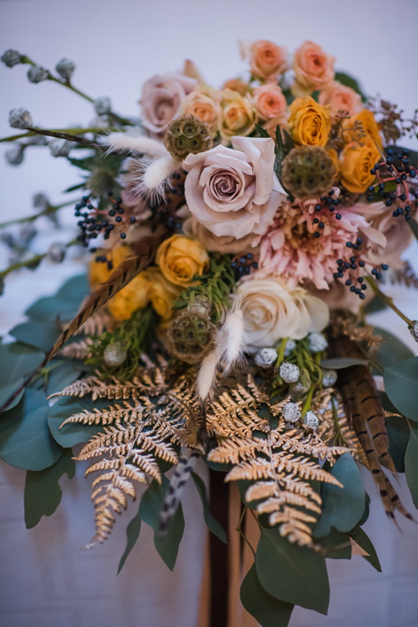 soft pink, orange, cream, brown and green make up this wedding bridal bouquet