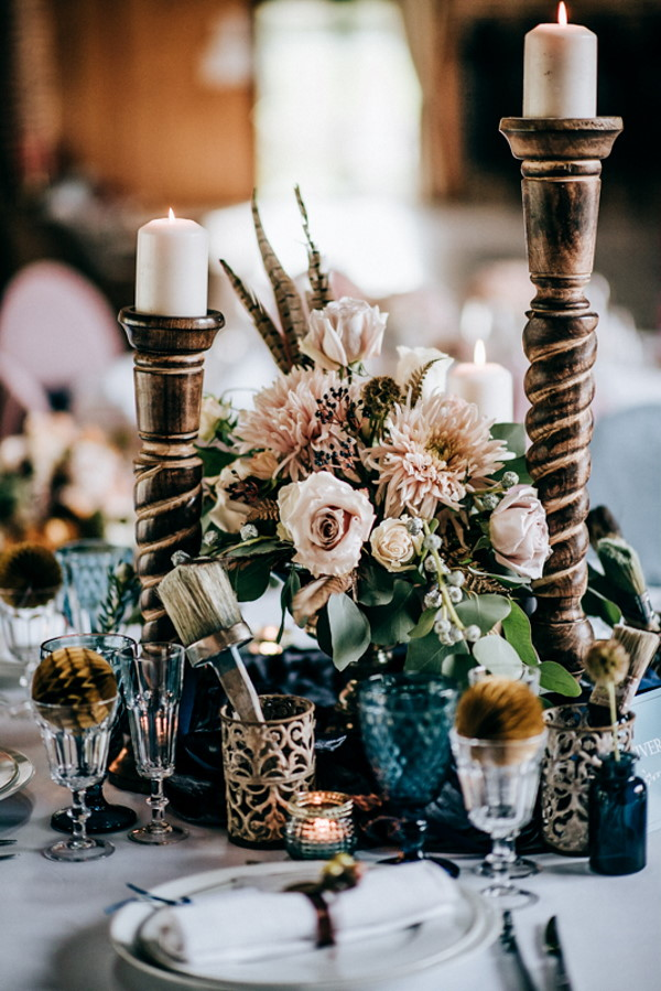 golden candle holders on wedding table