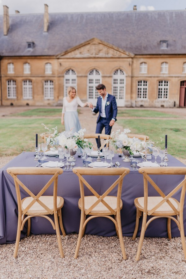 Blue themed wedding table set up in the courtyard of French Chateau Cons La Grandville