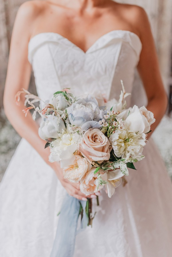 Bridal bouquet and strapless dress bust detailing