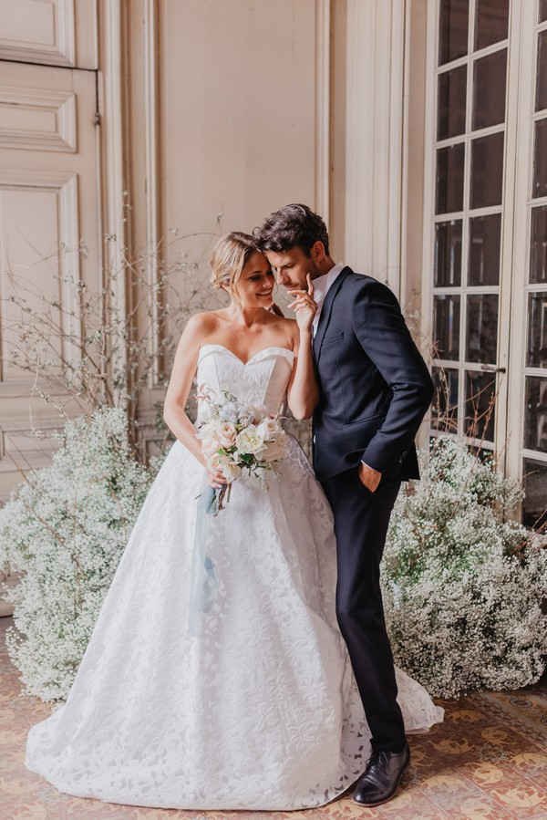 bride and groom surrounded by Baby's-breath flowers