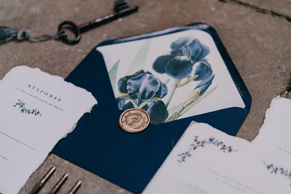Midnight blue envelope with RSVP wedding stationery and gold wax seal