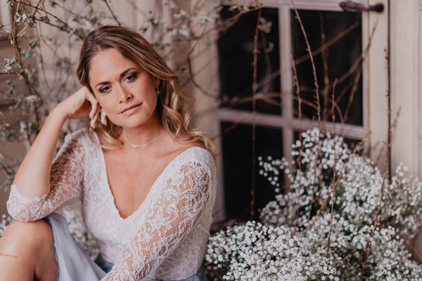 Bride in lace long sleeve top and pale blue skirt