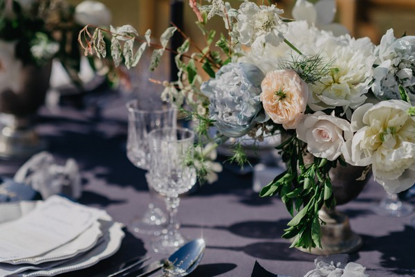 Wedding table decoration with crystal wine glasses and pastel flowers