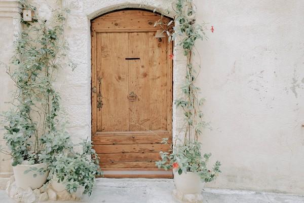 rustic wooden doorway surrounded by vines