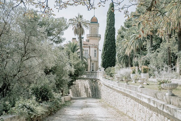 trees and palms line the garden drive in St Georges Castle, Grasse