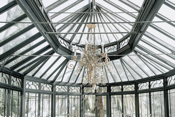 black ornate conservatory with chandelier
