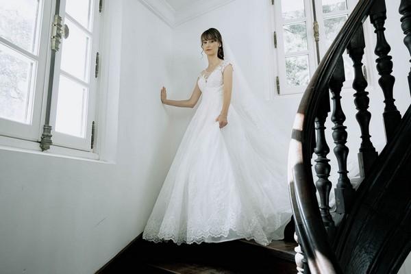 bride descending black spiral staircase