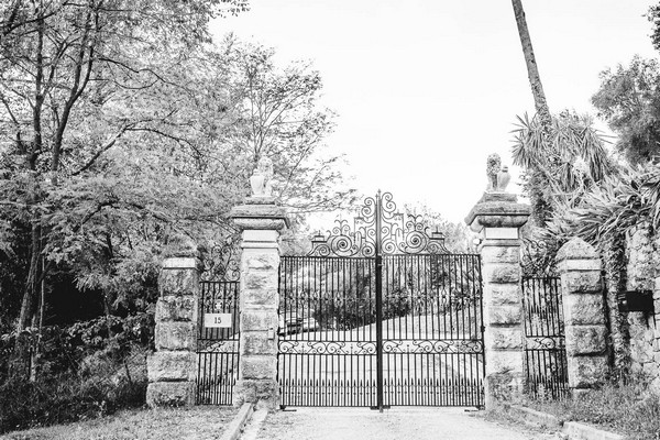 black and white image of wrought iron gates into Chateau St Georges in Grasse
