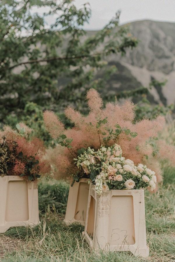 floral arrangements in old plastic bins
