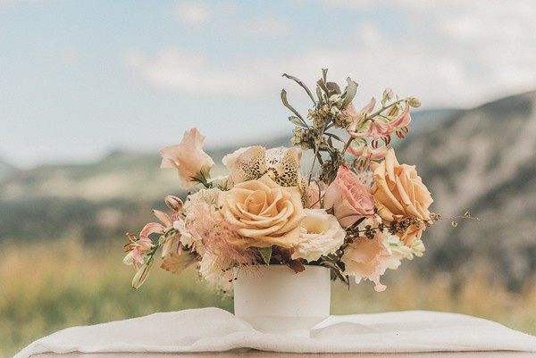 cream and pink floral arrangement with mountain views behind