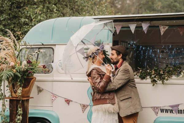 bride and groom under umbrella order ice cream from vintage ice cream van