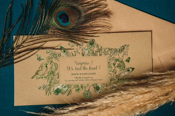 peacock feather and tea coloured wedding stationery