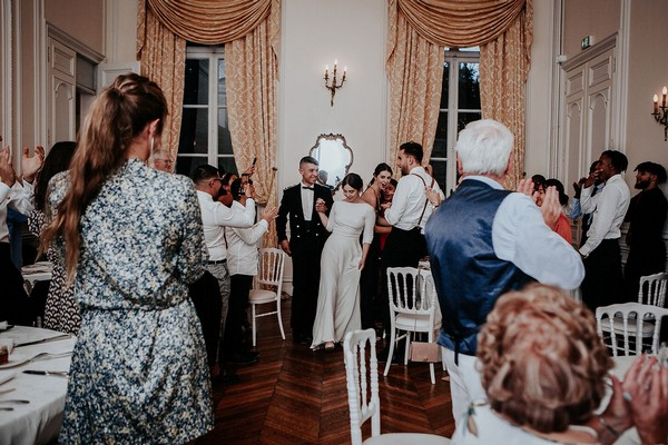 newly weds walk into chateau santeny reception room