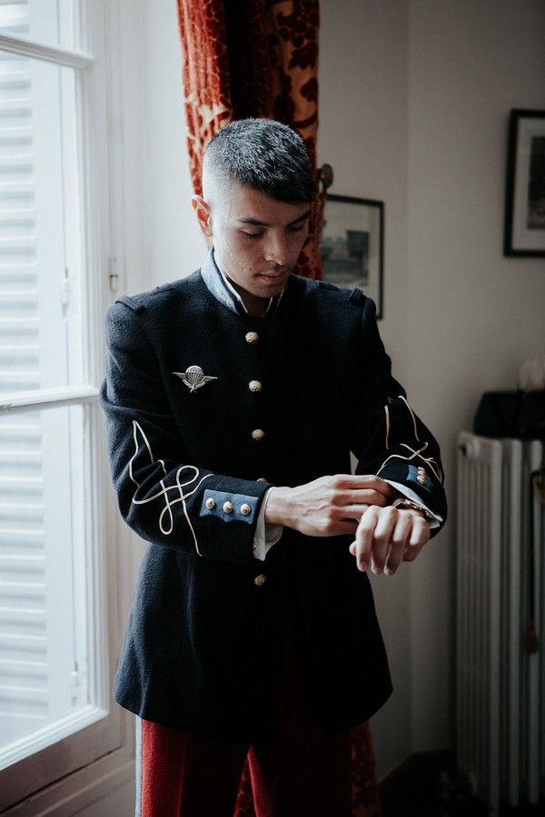 groom in military uniform gets ready for wedding
