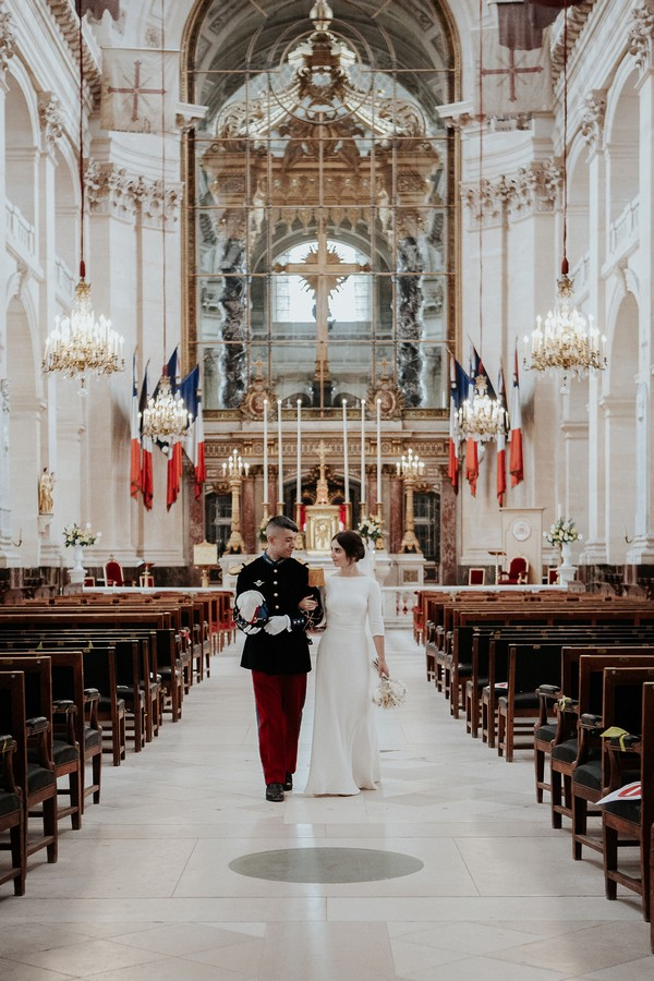 bride and groom walk back down the aisle of Cathedral of Saint Louis des Invalides after getting married