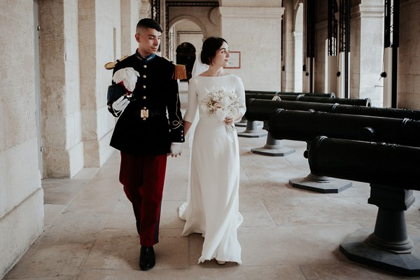 retro wedding over, the bride and groom walk through the grounds of Cathedral of Saint Louis des Invalides