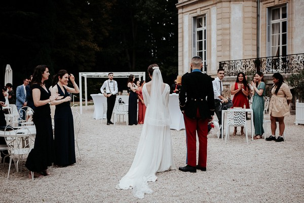 bride and groom arrive to their wedding reception at chateau santeny